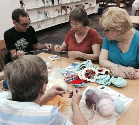 Craft Circle members work on projects at Sulzer Library