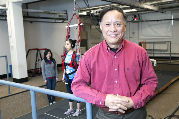Clive Pai in front of walkway for training seniors not to fall. Photo / Roberta Dupuis-Devlin/UIC Photo Services